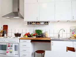 Apartments Modern Kitchen Tiny Apartment Decor Alongside Ivory Wall With Mounted Cabinet And Cooker Hood Ceramic As Counter Top