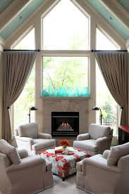 window above fireplace living room traditional with blue ottoman
