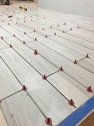 Floor Tile Leveling Spacers by Beautiful Floor Tile Leveling System Ideas Flooring U0026 Area Rugs