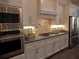 white kitchen cabinets gray granite countertops new caledonia