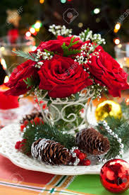 Winterberry Christmas Tree by Christmas Arrangement Of Red Roses Fir Holly And Pine Cones Stock