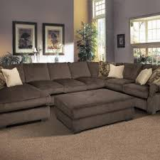 living room couch sectional with large glass windows and brown