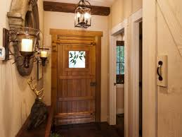 Image Of Breathtaking Rustic Entry Foyer Lighting Nearby Round Wood Framed Mirrors Between Wrought Iron Modish Hallway