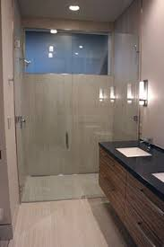 tiled bathroom floor and shower tile and installation by exact