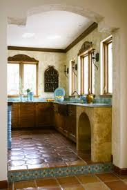 Detail Of Saltillo Tile Floor And Lower Cabinets In Turquoise Mexican Style Kitchen