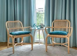 sitzecke mit zwei sessel aus rattan conscious design