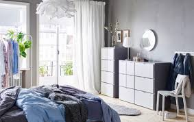 A Blue Grey And White Bedroom With Two VISTHUS Chest Of Drawers