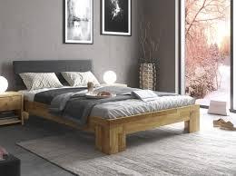elfo massivholz bettgestell bett eiche 140 x 200 cm eichenholz schwarzes kunstleder liegefläche ca 140 x 200 cm