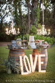 Wine Barrels And A Simple Wooden Tray For Cake Display Chandeliers To Add 30 Cute Rustic Summer Wedding Ideas