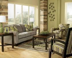 Amusing Earth Tones Living Room Decoration Using Black Flower Wall Mural Including Grey Velvet Sofa And Light Green