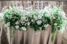 Sweetheart Table With Lots Of Greenery White Flowers
