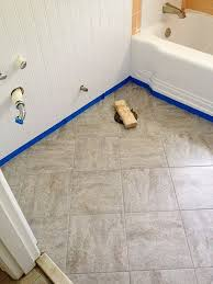 Tiling A Bathroom Floor Over Linoleum by Remodelaholic Bathroom Redo Grouted Peel And Stick Floor Tiles