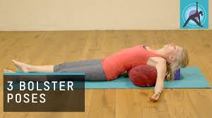 3 Yoga Poses Using A Bolster To Restore