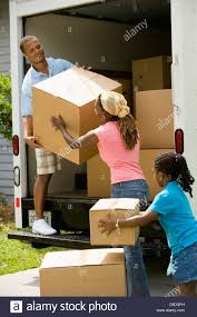 100 Packing A Moving Truck Family Unloading Boxes From A Moving Truck Stock Photo