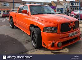 Large Bright Orange American Style Customised Pick-up Truck Parked ... Ford To Cut F150 And Large Suv Production Increase For Small 2018 Toyota Sequoia Tundra Fullsize Pickup Truck Trd 2016 Gmc Pickups A Size Every Need Chicago Car Guy Used Cars Trucks Glendive Sales Corp Whosale Dealer Mt 2007 Nissan D22 25 Di 4x4 Single Cab Pick Up Truck Amazing Runner 2012 F450 Dump Together With Insert For Sale The 1993 Silverado Is Large Pickup Truck Manufactured By Brabus G500 Xxl Is Very Wide Cool Offroad Full Traing Highly Raised Debary Miami Orlando Florida Panama Startech Range Rover Filled With Tires Driving On The Freeway