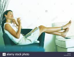 Woman Sitting Sideways On Armchair, Full Length Stock Photo ... Young Beautiful Woman Reading A Book In White Armchair Stock 1960s Woman Plopped Down In Armchair With Shoes Kicked Off Tired Woman In Armchair Photo Getty Images With Fashion Hairstyle And Red Sensual Smoking Black Image Bigstock Beautiful Business Sitting On 5265941 And Antique Picture 70th Birthday Cake Close Up Of Topp Flickr Using Laptop Royalty Free Pablo Picasso La Femme Au Fauteuil No 2 Nude Red 1932 Tate Sexy Sits 52786312