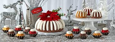 Bundt Cake Bundtlets And Bundtinis Surrounded By Silver White Ornaments