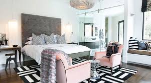 Lovely Gray Pink Bedroom With Tall Tufted Headboard White Black Mitered Pillows Chandeliers Placed Over Antique Console Tables Used As