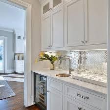 shiny backsplash white butler pantry with stainless steel mini