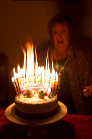 flames on a 70 candle cake