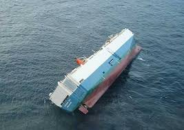 Many Ocean Going Cargo Ships Have Shipping Containers Stacked So High On The Deck How Is It That These Do Not Capsize