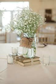 Simple Rustic Centerpiece Using Old Books Mason Jar Vases Babys Breath And