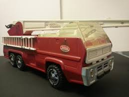 Vintage Toys: 1972 Tonka Aerial Fire Truck (Photo) | Charlie R. Claywell Kdw Diecast 150 Water Fire Engine Car Truck Toys For Kids Playing With A Tonka 1999 Toy Fire Engine Brigage Truck Ladders Vintage 1972 Tonka Aerial Photo Charlie R Claywell Buy Metal Cstruction At Bebabo European Toys Only 148 Red Sliding Alloy Babeezworld Nylint Collectors Weekly Toy Pinterest Antique Style 15 In Finish Emob Classic Die Cast Pull Back With Tin Isolated On White Stock Image Of Handmade Hand Painted Fire Truck