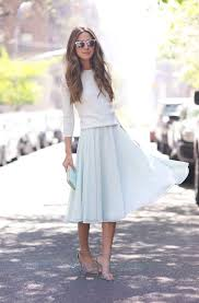 Here We See A Pretty Lady Covered In Lightweight White Sweater Paired With Pastel Light Blue Midi Skirt And Cuffed Grey Sandals