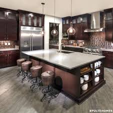 Rich Brown Hues Make This Modern Kitchen Feel Warm And