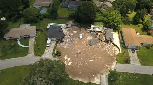 Growing Sinkhole Swallows 2 Houses, 1 Boat In Florida - LA Times Sinkhole Integral Permaculture Living On Earth Bayou Community Struggles With Sinkhole A Gaping In Florida Is Swallowing Everything Its Path Pasco County Leaders Caution Rebuilding Near Site Extraordinary Small In Backyard Images Decoration Inspiring Pictures Inspiration Amys How To Repair Yard Sinkholes Designed Landscapes Youtube Abc11com Wrecks Falmouth Familys Home The Chronicle Herald Opens Australian Video Nytimescom