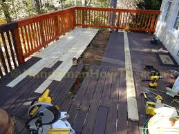 Restaining A Deck Do It Yourself by How To Replace Wood Deck Boards Remove The Old Deck Boards In