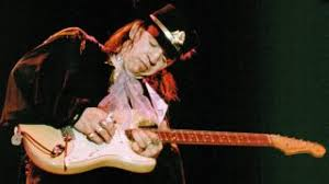 Stevie Ray Vaughan Playing Guitar Onstage