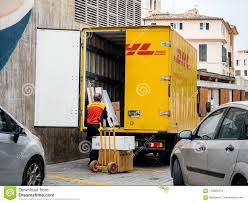 Senior Worker Discharge DHL Parcels From Truck In Central Square ...