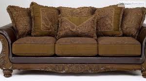 Claremore Sofa And Loveseat by Wilmington Walnut Living Room Collection From Signature Design By