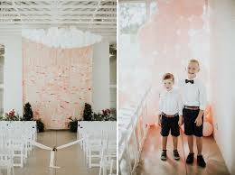 Fun Fueled Modern Wedding With Pops Of Red Balloons Galore