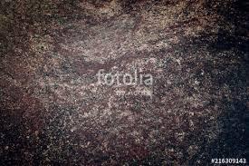 Texture Of A Dark Brown Granite Slab Light Spot On Background