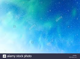 Beautiful Northern light blue starry sky background forces of