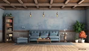 foto auf lager rustikales wohnzimmer mit alten wänden blauem sofa und holzdecke