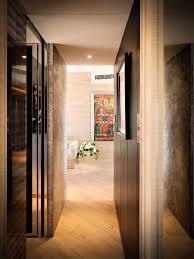 chic uplight on wooden floor closed door fit to hallway