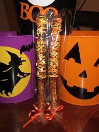 Halloween Pretzel Rod Treats by White Chocolate Pretzel Rods W Gray Yellow And White Chocolate
