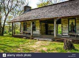 A Charming Rustic Log Cabin With Front Porch And Seats In 19th Century Style Is Beautiful Simplistic Pane Glass Windows