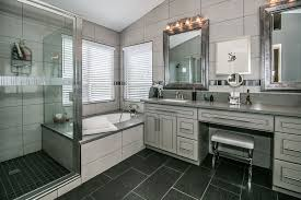 contemporary master bathroom with specialty tile floors flush in