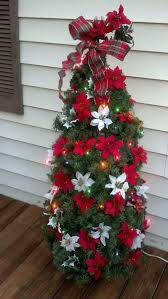 Small Tomato Cage Christmas Tree With Red And White Poinsettia Flowers
