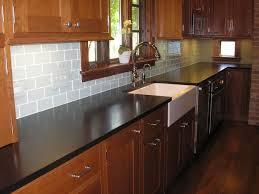 Kitchen Backsplash Ideas For Dark Cabinets by Best 25 Backsplash Black Granite Ideas On Pinterest Black