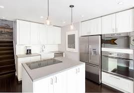 Modern Kitchen With White Cabinets Dark Wood Floors And Corian Solid Surface Counters