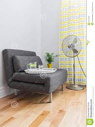 Living Room With Armchair And Electric Fan Stock Photo - Image ... Living Room Hardwood Flooring Blue Armchair Brown Backbutton French Fniture In The Eighteenth Century Seat Essay Best 25 Bedroom Armchair Ideas On Pinterest Eric Coent Marketing Agency Ldon 12 Things Every Arm Chairs Armchairs And Hans Wegner Ample Seating For All Comfy Reading Big Fan Collection Products Profim Ipirations Fit Unique Classic Twitter Your Boys Are Streaking Dubai For