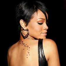 Rihanna Has A Trail Of Stars That Begins From Her Nape And Trails Down To Upper Back The Star Tattoo Is One Most Visible Famous