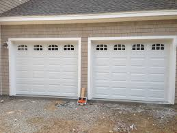 Haas model 680 Steel Raised Panel Garage Doors in White with