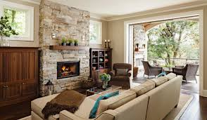 stone fireplace with wooden mantel creating greater warmth in room