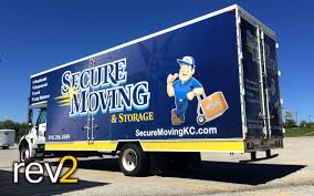 Box Truck Wraps- Secure Moving - REV2 Vehicle Wraps | Kansas City | Blog Coastal Roofing Box Truck Wrap Sign Design Llc Van Car Wraps Graphic 3d Partial Wrapping Company Brooklyn Signs Lucent Vinyl Lab Nw Team Lownstein Paradise Vehicle Inc Boxtruckwrapsinc Graphics Dynamark Group Nashville Trucks Grafics Unlimited Raptor Plumbing Geckowraps Las Vegas And Nyc